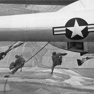 Paratroopers drop from U.S. Air Force C-119 transport planes during an operation over an undisclosed location in Korea, in October of 1950.