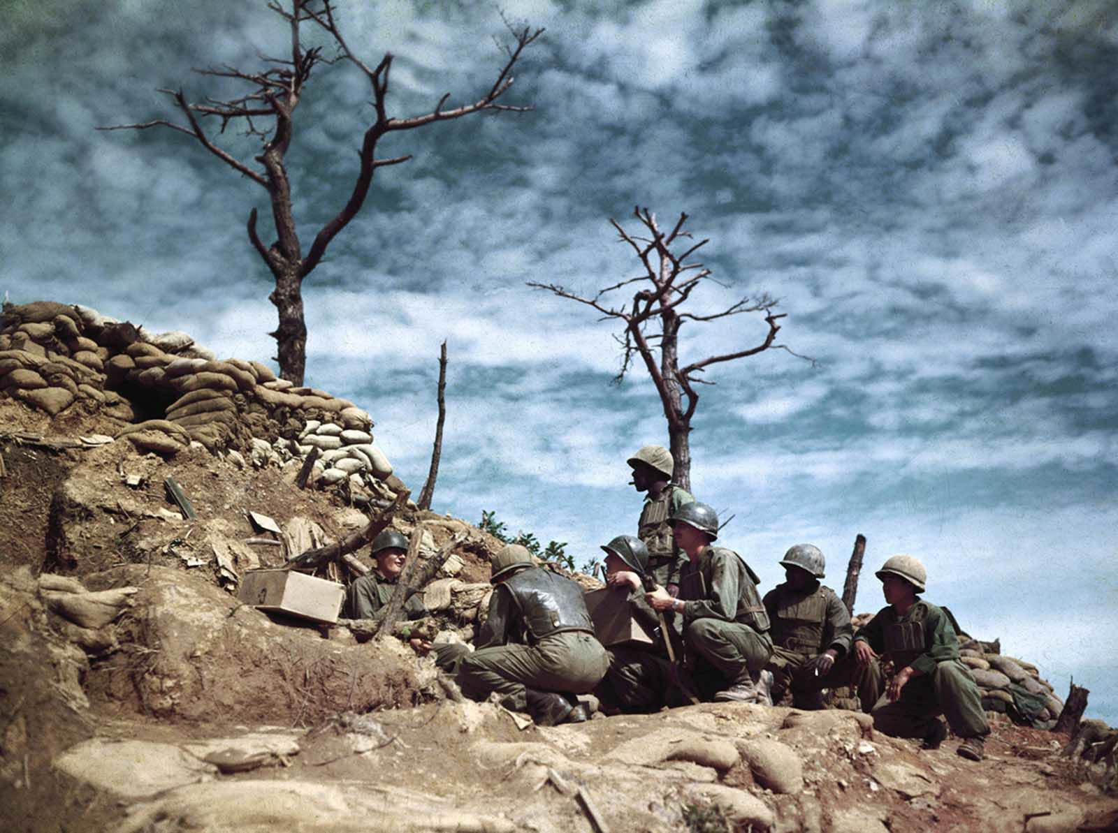 Soldiers digging into bunkers atop Old Baldy in Korea in 1952.
