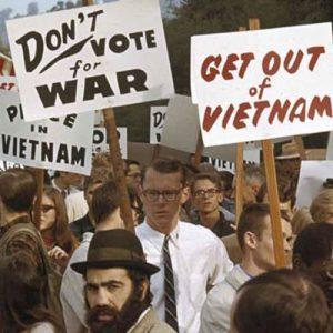 In Berkeley-Oakland City, California, demonstrators march against the war in Vietnam in December of 1965.